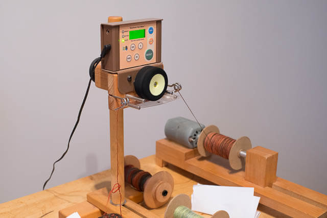 Measuring yardage with a yardage counter and double-ended bobbin winder