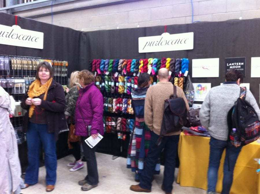 Sarah chats with customers at the Purlescence stand at Wonderwool Wales — one of a number of shows the shop attends each year.